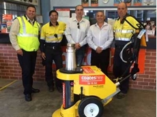 Enerpac and Coates Hire representatives with the Pow'R-LOCK auto-locking lifting system
