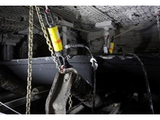 Securely anchored Enerpac BRP pull cylinders are powered by an XC cordless pump for conveyor maintenance