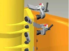 Bolts are precisely torqued by Enerpac X-Edition torque wrenches, right, with backing tools on the other side of the yellow flanges