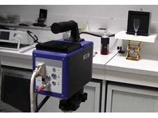The FLIR SC7000 thermal imaging camera is pointed at a champagne flute standing before a calibrated blackbody