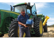 Grain farmer with the FOSS Infratec™ Sofia grain analyser