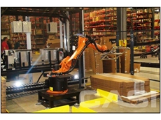 A random size case erector developed by CASI that uses robotics to select correct carton size