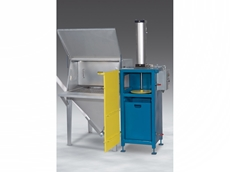 Flexicon's new manual bag dump system with compactor and conveyor