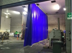 Flexshield's wash bay screen for Komatsu