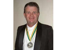 Sandy Gray with the medal.