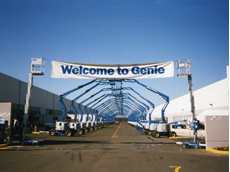 An archway of Genie Z-34/22 articulating boom lifts circa 1989