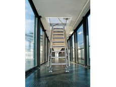 Gorter's scissor stair/ attic ladder used in an airport walkway where safe access to the roof was required without obstructing the passageway