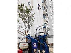 Graco's electric airless sprayer was used to paint the exterior wall of a 13-floor residential building in China using a safety harness