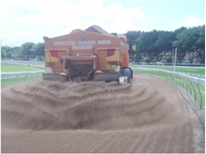 Specialised spreading vehicle being used on Randwick Racecourse