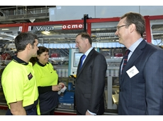 OCME engineers present their machinery to the New Zealand Prime Minister John Key and Coca Cola Amatil Managing Director George Adams
