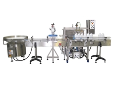 Riggs Autopack's volumetric filling and lidding machine