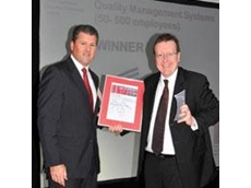 Shane Elkin (right) - North West Region Director (Heggies) receiving award from Duncan Lilley (left), Global Head of Assurance Service (SAI Global)