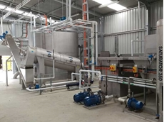 HUBER Q280 screw press dewatering DAF sludge at a meat processing plant