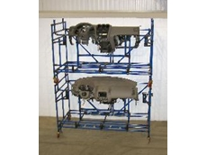 Two Creform stackable shipping racks holding automotive parts.