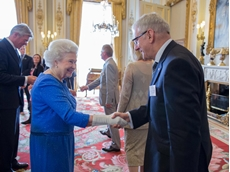 Her Majesty, Queen Elizabeth II congratulates Ishida Europe's Managing Director Graham Clements