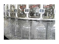 Volumetric normal pressure filling system