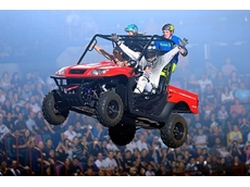 Nitro Circus perform a jump in the Kymco UXV 500 4 x 4 side by side