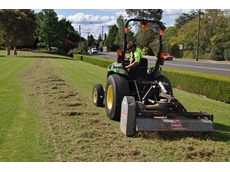 A tractor-drawn scarifier from Kennards Groundcare Hire removes a thick mat of thatch from the church grounds.