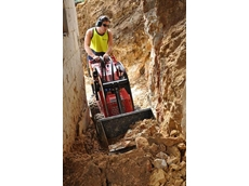 Henry Bryce operates the K9-2 Dingo from Kennards Hire in the narrow cavity