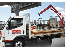 Hired crane trucks used to install anti-throw screens