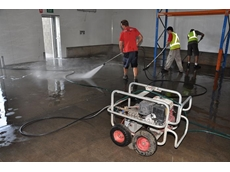A Kennards' 4000psi water blaster helps with the clean-up at the Brisbane Produce Market at Rocklea