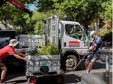 The garden beds had to be winched and strapped onto trolleys, and lifted into place