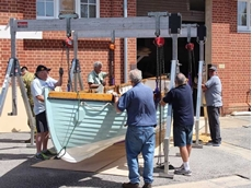 Kennards Hire Lift & Shift supplied two aluminium gantries and four chain blocks to lift the 1.2 tonne timber boat from the transport trailer and place it onto the frame
