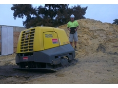 Craig Milner operates a vibratory plate compactor on an Oostveen project.