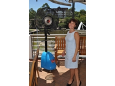 Anna Panton, manager of the Port Bar cools down in front of a misting fan