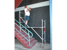 New mini scaffold provides a safe, level platform for work above stairs.