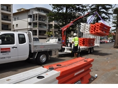 Barriers are picked up from a building site at Manly