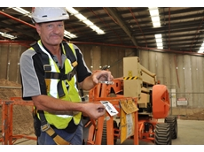 Lyle Kimber scans the bar code while using a 15m boom lift from Kennards Hire
