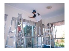 Aluminium trestles make painting high areas a lot easier and safer.