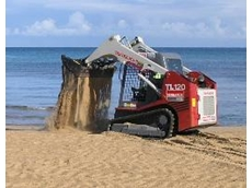 The rubber-tracked loader returns sand to Frankston Beach