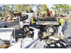 A council crew uses a Kennards tipper in the clean-up after the floods