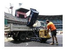 Steve Townsley operates a Kennards' high-lift dumper on the MCG.