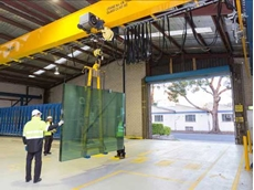 A Konecranes CXT crane lifting a sheet of glass at the Viridian Trade Centre