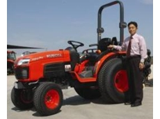 Tractors: Mr Kazumi Suehira with an export model Kubota tractor