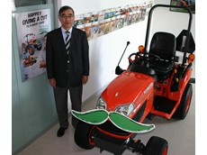 Kubota Managing Director with a Kubota tractor complete with moustache