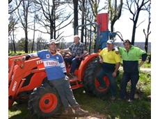 Alex Sutherland of the VFF (on tractor) with property owner Matt Redpath (right) and volunteers Tyson Jarviss and Ron Harbridge work on re fencing in Kinglake.