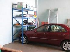 Tuck In shelving systems for garages and sheds
