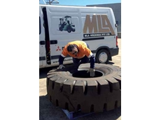 MLA technician inspecting a potentially dangerous 1800 x 25 tyre for any faults