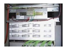 This panel, located within the control cabinet, performs amp metering of individual drives and features clearly marked quick-release plugs and sockets
