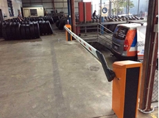 Magnetic Automation installed the boom gates at the warehouse's loading dock