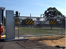 Magnetic's heavy duty cantilever gates and pedestrian turnstile installed at oil and gas plant