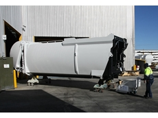 A 10 tonne Electrodrive tug easily moves this rubbish truck enclosure