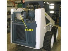 Compact filter cartridge in skid steer loader