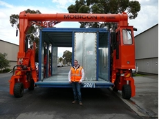 Unitised Building's Mobicon operator, Harry Antoniou with Mobicon ready to move a factory-built unit