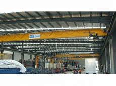 Three 22m wide overhead cranes sharing common rails are all synchronised.