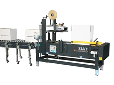 Packing boxes with the SIAT PS50-TB combo station, now available from Optimum Handling Solutions